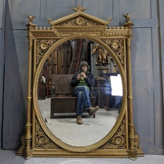 Giant 1885 Highly Ornate Exuberant Carved Gold Painted Oval Mirror with Griffins