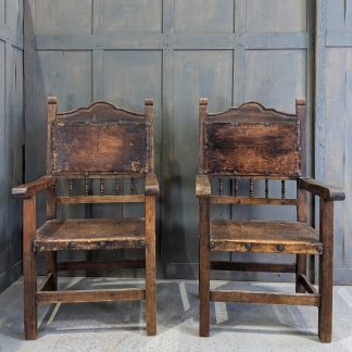 Pair of Vintage 17th Century Style Spanish Leather Upholstered Baronial Chairs