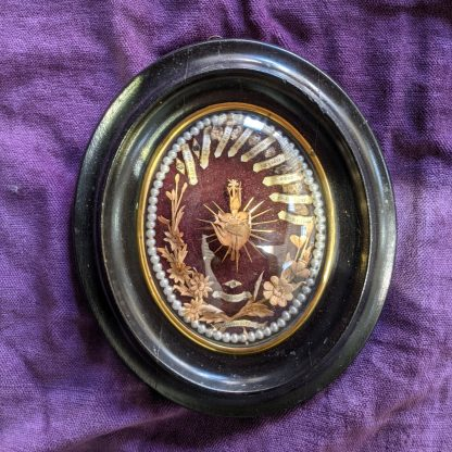 Antique French Reliquary with Labelled Relics in Moulded & Ebonised Frame