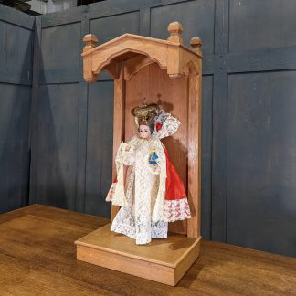 Antique Crowned Child of Prague Statue with Glass Eyes & Various Vestments in Oak Niche Display Stand